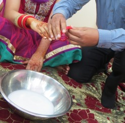 Ritual symbolic of purity where the bride's uncle places the wedding bangles onto his niece, before bathing in milk.